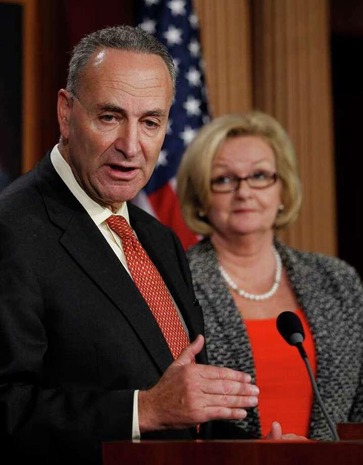 ALEX BRANDON : AP BEFORE: McCaskill, shown with Sen. Charles Schumer, D-N.Y. in August 2010, is facing a tough re-election bid next year. Photo: Alex Brandon / AP