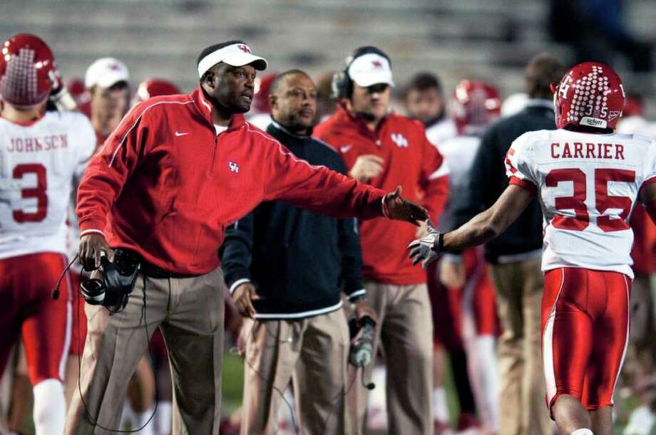 Houston coach Kevin Sumlin celebrates with player Tyron Carrier (35) during the first half of their NCAA college football game against UAB in Birmingham, Ala., Saturday, Nov. 5, 2011. Houston defeated UAB 56-13. (AP Photo/Bob Farley) Photo: Bob Farley, Associated Press / AP