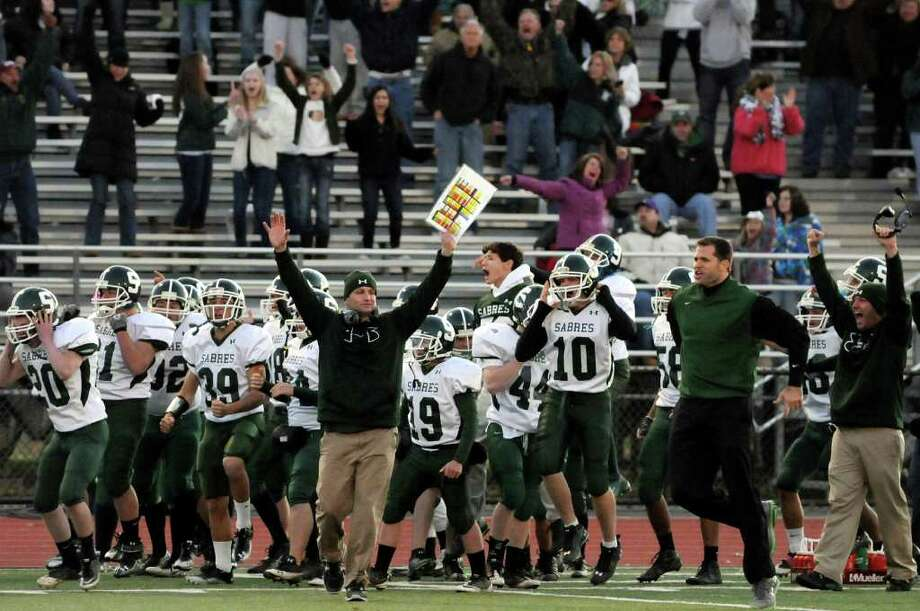 Schalmont's coach Joe Whipple, center, raises his arms as his team wins their Section II Class B Super Bowl football game over Albany Academy on Saturday, Nov. 5, 2011, at Shenendehowa High in Clifton Park, N.Y. Schalmont wins 37-35 in overtime. (Cindy Schultz / Times Union) Photo: Cindy Schultz / 00015202A