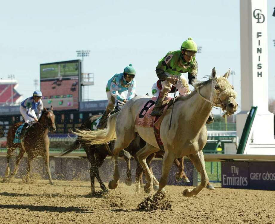Garrett Gomez rides Cease to victory in the Marathon race at the Breeders' Cup horse races at Churchill Downs Saturday, Nov. 5, 2011, in Louisville, Ky. (AP Photo/Darron Cummings) Photo: Darron Cummings