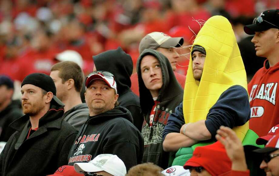ERIC FRANCIS : GETTY IMAGES CREAMED CORN: Nebraska fans survey the grim scene as the final seconds of a 28-25 loss to Northwestern tick off. Nebraska entered the game as a 17-point favorite. Photo: Eric Francis / 2011 Getty Images