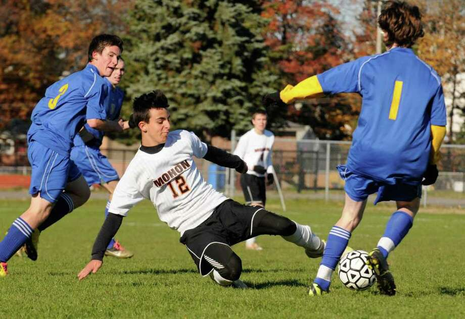 Mohonasen's Lucas Alberdi and Queensbury's Branden Kietzman battle for the ball during their Section II Class A Boys Soccer final in Colonie, NY Saturday, Nov.5, 2011.( Michael P. Farrell/Times Union) Photo: Michael P. Farrell