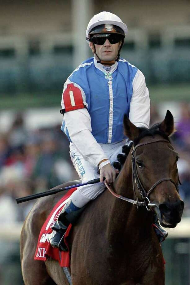 LOUISVILLE, KY - NOVEMBER 05: Jockey Olivier Peslier comes back aboard Goldikova after finishing third in the Breeders' Cup Mile during the 2011 Breeders' Cup World Championships at Churchill Downs on November 5, 2011 in Louisville, Kentucky.  (Photo by Rob Carr/Getty Images) Photo: Rob Carr