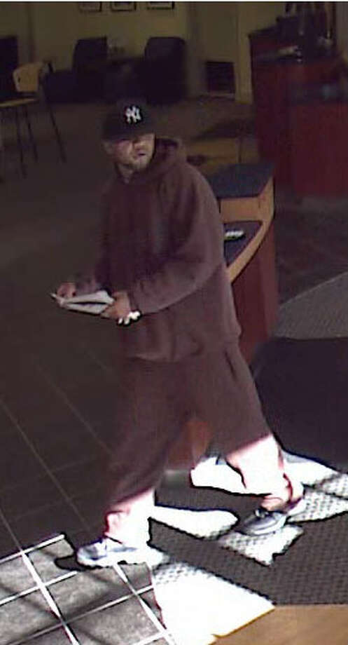 Greenwich Police are searching for this man, who is suspected of robbing the People's United Bank at the bottom of Greenwich Avenue on Saturday morning, Nov. 5, 2011. Photo: Contributed Photo