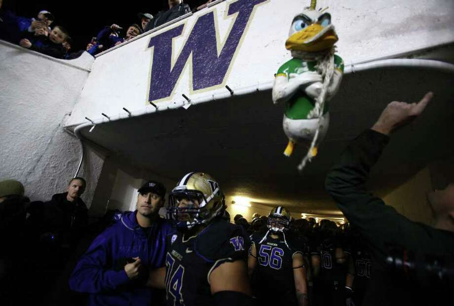 Head coach Steve Sarkisian introduces senior Alameda Ta'amu at Husky Stadium before a game against the Oregon Ducks on Saturday, November 5, 2011.  Photo: JOSHUA TRUJILLO / SEATTLEPI.COM