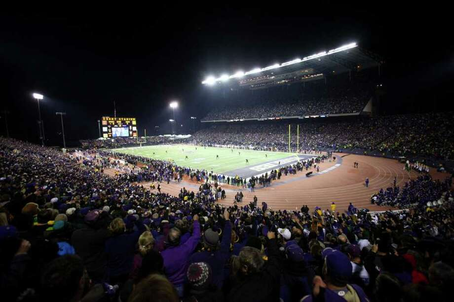 Fans cheer during kickoff at Husky Stadium during a game against the Oregon Ducks on Saturday, November 5, 2011.  Photo: JOSHUA TRUJILLO / SEATTLEPI.COM