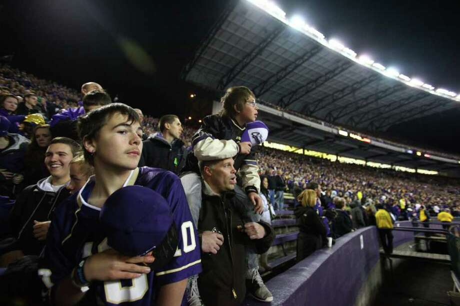 Fans listen to the National Anthem at Husky Stadium during a game against the Oregon Ducks on Saturday, November 5, 2011.  Photo: JOSHUA TRUJILLO / SEATTLEPI.COM