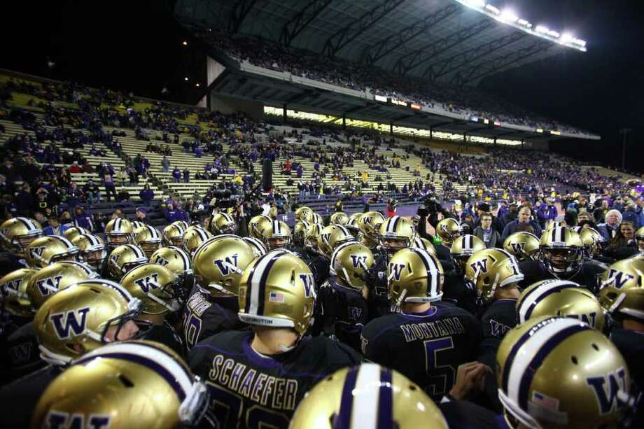 Players take the field at Husky Stadium during a game against the Oregon Ducks on Saturday, November 5, 2011. Photo: JOSHUA TRUJILLO / SEATTLEPI.COM