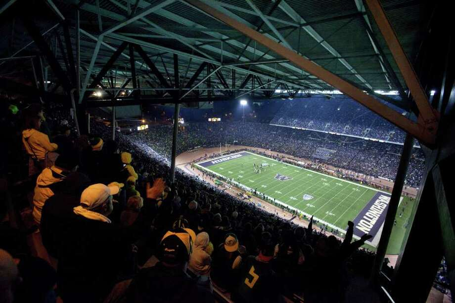 Fans in the highest rows in Husky Stadium cheer during a game against the Oregon Ducks on Saturday, November 5, 2011. The game was the last to be held at the aging stadium. Beginning next week demolition of the stadium will begin. Photo: JOSHUA TRUJILLO / SEATTLEPI.COM