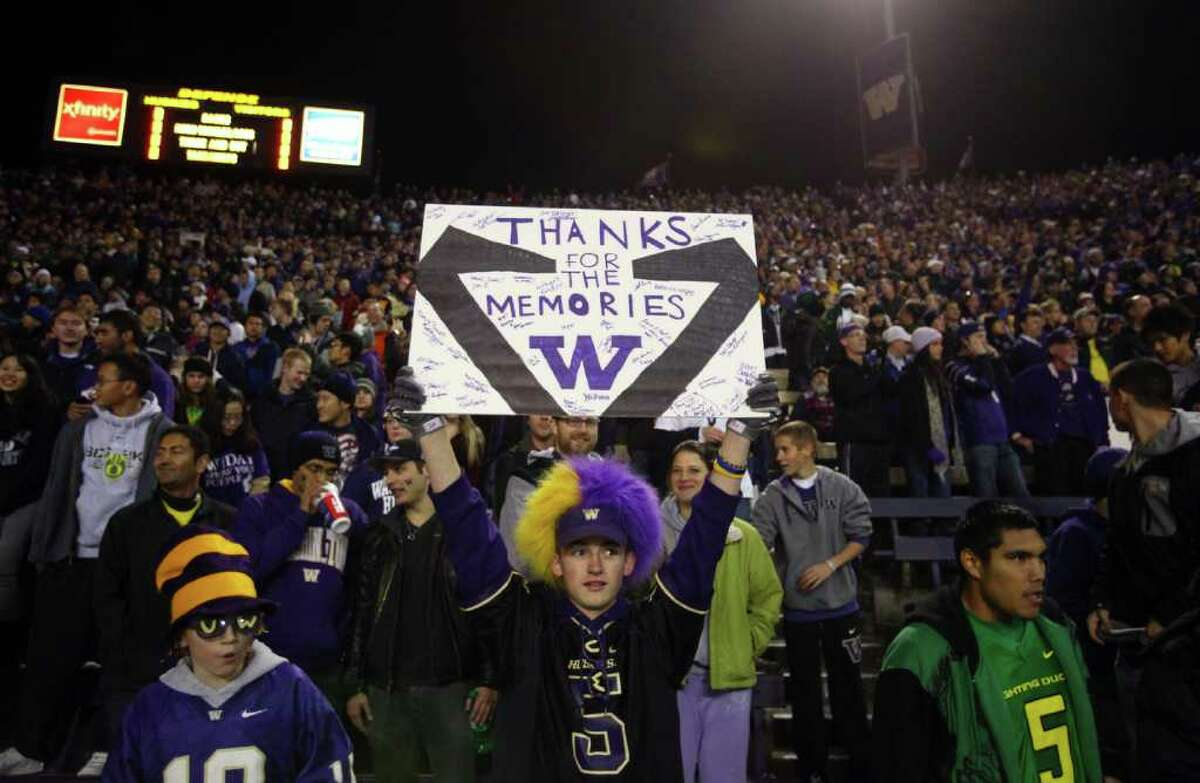 A fan holds up a sign thanking the stadium for the memories at Husky Stadium during a game against the Oregon Ducks on Saturday, November 5, 2011.