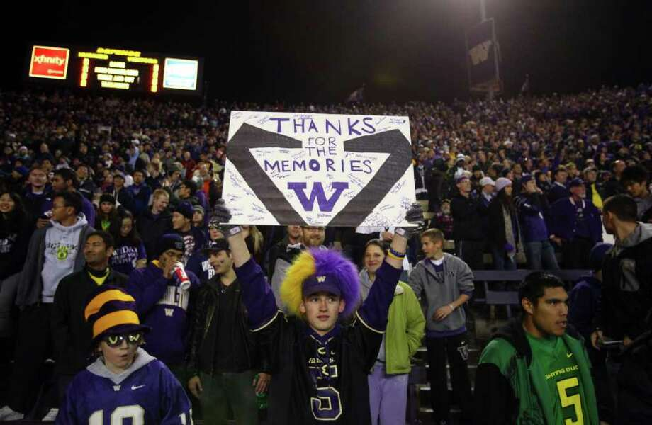 A fan holds up a sign thanking the stadium for the memories at Husky Stadium during a game against the Oregon Ducks on Saturday, November 5, 2011.  Photo: JOSHUA TRUJILLO / SEATTLEPI.COM