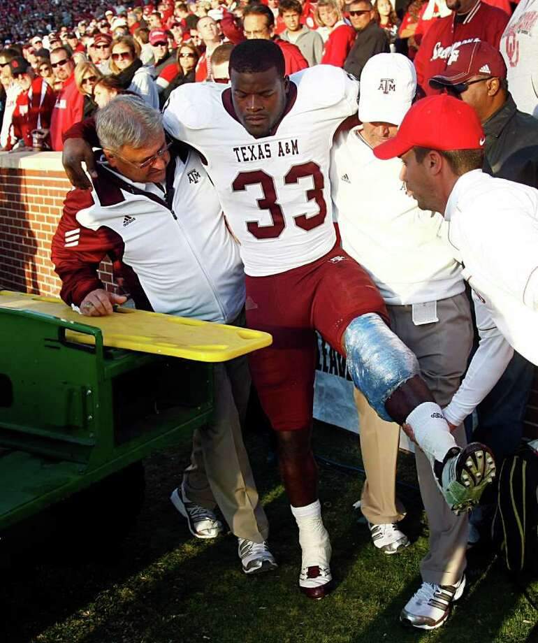 Texas A&M running back Christine Michael (33) is helped onto a cart after injuring his left leg in the second half against Oklahoma at Oklahoma Memorial Stadium on Saturday, November 5, 2011, in Norman, Oklahoma. The host Sooners defeated Texas A&M, 41-25. (Tom Fox/Dallas Morning News/MCT) Photo: Tom Fox, McClatchy-Tribune News Service / Dallas Morning News