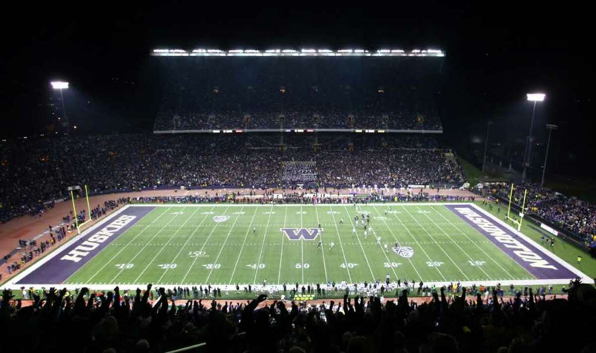 Fans cheer their team at Husky Stadium during a game against the Oregon Ducks on Saturday, November 5, 2011. The game was the last to be held at the aging stadium. Beginning next week demolition of the stadium will begin.