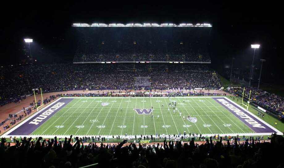 Fans cheer their team at Husky Stadium during a game against the Oregon Ducks on Saturday, November 5, 2011. The game was the last to be held at the aging stadium. Beginning next week demolition of the stadium will begin. Photo: JOSHUA TRUJILLO / SEATTLEPI.COM
