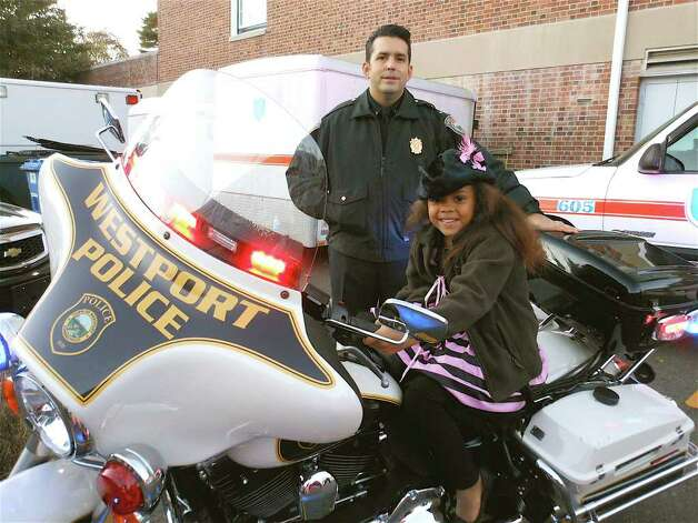 Dorothy Djangmah, 6, with Lt. Vincent Penna at the Westport ...