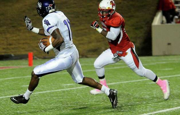 SFA's Brandon Scott runs the ball as Lamar's Michael Allen II attempts to run him down at the Provost Umphrey Stadium at Lamar University in Beaumont, Saturday, November 5, 2011. Tammy McKinley/The Enterprise Photo: TAMMY MCKINLEY