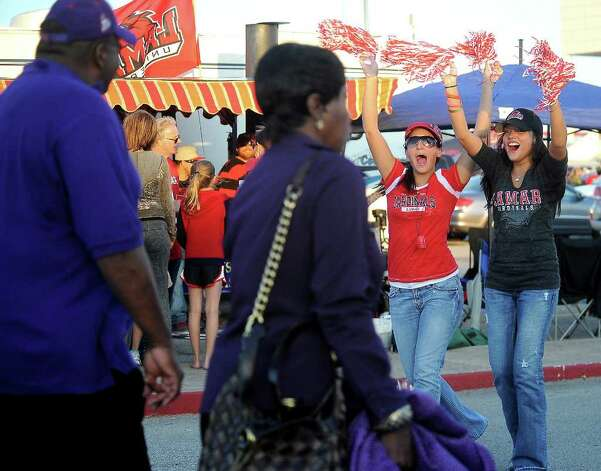 Lamar tailgaters, Erica Lopez and Melissa Jimenez cheer as Stephen F. Austin fans walk by before the game at the Provost Umphrey Stadium at Lamar University in Beaumont, Saturday, November 5, 2011. Tammy McKinley/The Enterprise Photo: TAMMY MCKINLEY