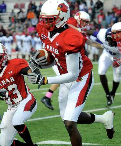 Lamar's Marcus Jackson carries the ball during the game against Stephen F. Austin at the Provost Umphrey Stadium at Lamar University in Beaumont, Saturday, November 5, 2011. Tammy McKinley/The Enterprise Photo: TAMMY MCKINLEY