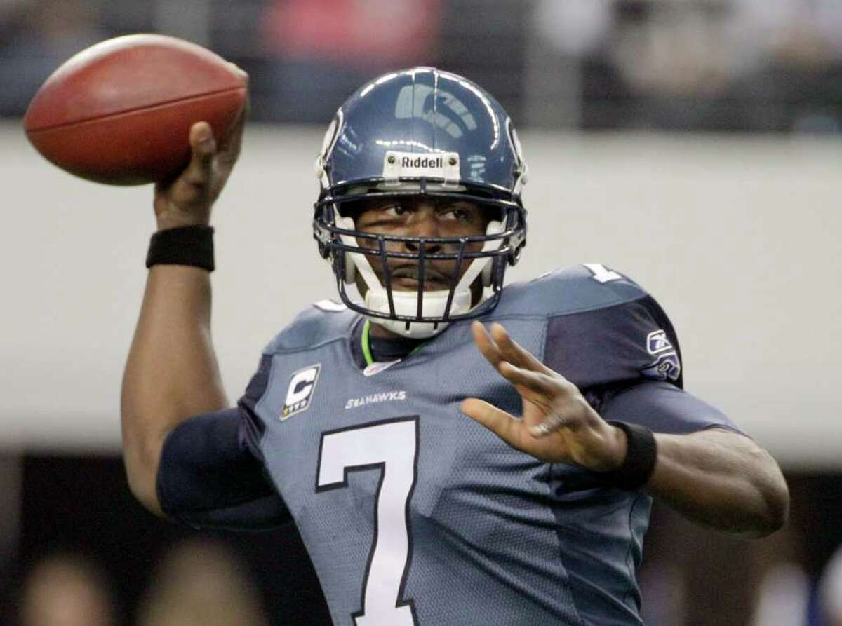 Seattle Seahawks quarterback Tarvaris Jackson looks to pass against the Dallas Cowboys during the first half of an NFL football game Sunday, Nov. 6, 2011, in Arlington, Texas.