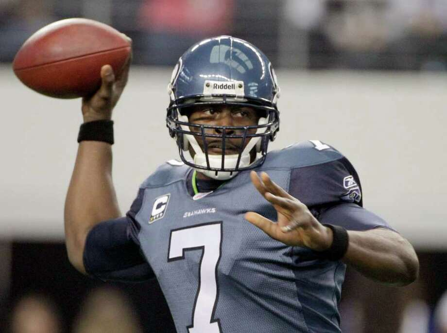 Seattle Seahawks quarterback Tarvaris Jackson looks to pass against the Dallas Cowboys during the first half of an NFL football game Sunday, Nov. 6, 2011, in Arlington, Texas. Photo: AP
