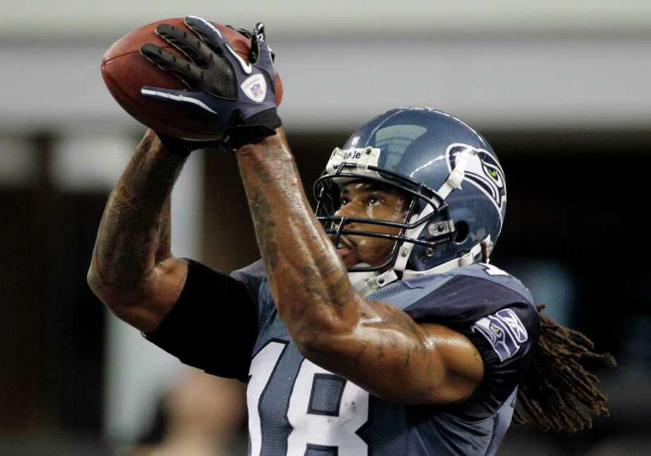Seattle Seahawks wide receiver Sidney Rice catches the ball before an NFL football game against the Dallas Cowboys Sunday, Nov. 6, 2011, in Arlington, Texas. Photo: AP