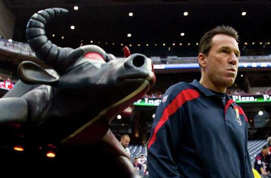 Houston Texans head coach Gary Kubiak walks onto the field before an NFL football game against the Cleveland Browns at Reliant Stadium on Sunday, Nov. 6, 2011, in Houston. Photo: Brett Coomer, Houston Chronicle / © 2011  Houston Chronicle