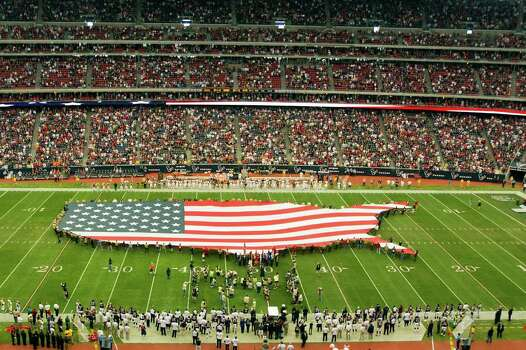 A large American flag in the shape of the United States is unfurled before the Houston Texans play the Cleveland Browns in an NFL football game at Reliant Stadium on Sunday, Nov. 6, 2011, in Houston. Photo: Smiley N. Pool, Houston Chronicle / © 2011  Houston Chronicle