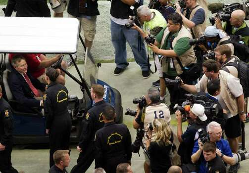Photographers crowd around former President George H. W. Bush before the Houston Texans play the Cleveland Browns in an NFL football game at Reliant Stadium on Sunday, Nov. 6, 2011, in Houston. Photo: Smiley N. Pool, Houston Chronicle / © 2011  Houston Chronicle