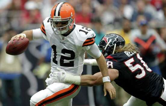 Cleveland Browns quarterback Colt McCoy (12) is forced out of the pocket by Houston Texans outside linebacker Brooks Reed (58) during the second quarter of an NFL football game at Reliant Stadium on Sunday, Nov. 6, 2011, in Houston. Photo: Brett Coomer, Houston Chronicle / © 2011  Houston Chronicle