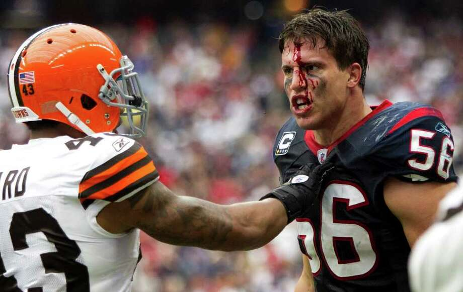 Houston Texans inside linebacker Brian Cushing (56) is held back by Cleveland Browns strong safety T.J. Ward (43) after Cushing was involved in an altercation with Cleveland Browns offensive guard Shawn Lauvao during the second quarter of an NFL football game at Reliant Stadium on Sunday, Nov. 6, 2011, in Houston. Photo: Brett Coomer, Houston Chronicle / © 2011  Houston Chronicle