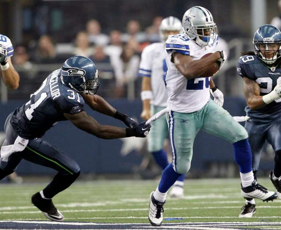Dallas Cowboys' DeMarco Murray (29) takes the ball downfield as Seattle Seahawks' Kam Chancellor (31) defends during the first  half of an NFL football game on Sunday, Nov. 6, 2011, in Arlington, Texas. Photo: AP