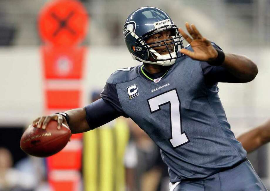 Seattle Seahawks quarterback Tarvaris Jackson throws the ball against the Dallas Cowboys during the first half of an NFL football game on Sunday, Nov. 6, 2011, in Arlington, Texas. Photo: AP