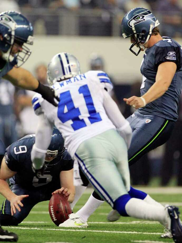 Dallas Cowboys' Terence Newman (41) blocks a field goal-attempt by Seattle Seahawks' Steven Hauschka, right, during the second half of an NFL football game on Sunday, Nov. 6, 2011, in Arlington, Texas. Seattle Seahawks' Jon Ryan (9) holds. Photo: AP