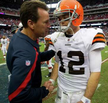 Houston Texans head coach Gary Kubiak shakes hands with Cleveland Browns quarterback Colt McCoy (12) after the Texans beat the Browns in an NFL football game at Reliant Stadium on Sunday, Nov. 6, 2011, in Houston. The Texans beat the Browns 30-12. Photo: Brett Coomer, Houston Chronicle / © 2011  Houston Chronicle