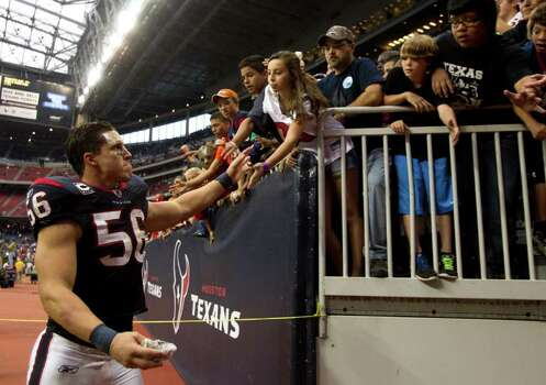 Houston Texans inside linebacker Brian Cushing (56) high-fives fans as he leaves the field after beating the Cleveland Browns in an NFL football game at Reliant Stadium on Sunday, Nov. 6, 2011, in Houston. The Texans beat the Browns 30-12. Photo: Brett Coomer, Houston Chronicle / © 2011  Houston Chronicle