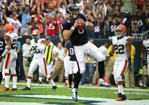 Houston Texans quarterback Matt Schaub (8) celebrates his 2-yard touchdown run against the Cleveland Browns during the first quarter of an NFL football game at Reliant Stadium on Sunday, Nov. 6, 2011, in Houston. The Texans beat the Browns 30-12. Photo: Brett Coomer, Houston Chronicle / © 2011  Houston Chronicle