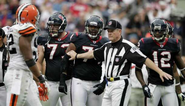 Field judge Scott Steenson (88) stands between Houston Texans and Cleveland Browns players during the third quarter of an NFL football game at Reliant Stadium on Sunday, Nov. 6, 2011, in Houston. The Texans beat the Browns 30-12. Photo: Brett Coomer, Houston Chronicle / © 2011  Houston Chronicle