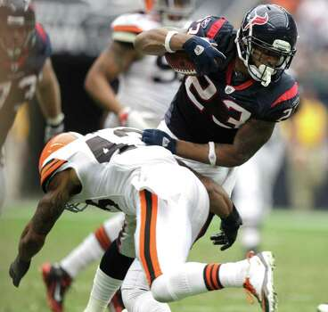 Houston Texans running back Arian Foster (23) cuts back across the field past Cleveland Browns strong safety T.J. Ward (43) during the third quarter of an NFL football game at Reliant Stadium on Sunday, Nov. 6, 2011, in Houston. The Texans beat the Browns 30-12. Photo: Brett Coomer, Houston Chronicle / © 2011  Houston Chronicle