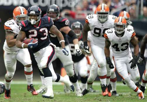 Houston Texans running back Arian Foster (23) breaks through the Cleveland Browns defense during the third quarter of an NFL football game at Reliant Stadium on Sunday, Nov. 6, 2011, in Houston. The Texans beat the Browns 30-12. Photo: Brett Coomer, Houston Chronicle / © 2011  Houston Chronicle