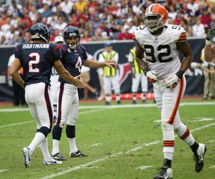 Houston Texans kicker Neil Rackers (4) celebrates his 21-yard field goal with holder Brett Hartman (2) against the Cleveland Browns during the third quarter of an NFL football game at Reliant Stadium on Sunday, Nov. 6, 2011, in Houston. The Texans beat the Browns 30-12. Photo: Brett Coomer, Houston Chronicle / © 2011  Houston Chronicle