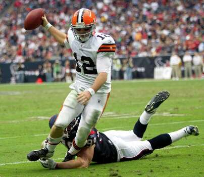 Cleveland Browns quarterback Colt McCoy (12) is forced out of the pocket by Houston Texans defensive end J.J. Watt (99) during the fourth quarter of an NFL football game at Reliant Stadium on Sunday, Nov. 6, 2011, in Houston. The Texans beat the Browns 30-12. Photo: Brett Coomer, Houston Chronicle / © 2011  Houston Chronicle