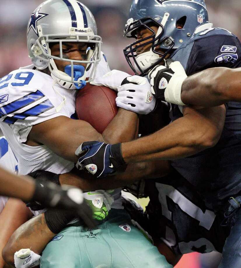 Dallas Cowboys' DeMarco Murray is tackled by  Seattle Seahawks' K.J. Wright and others on a kickoff return during first half action Sunday Nov. 6, 2011 at Cowboys Stadium in Arlington, TX. Photo: EDWARD A. ORNELAS, Express-News / © SAN ANTONIO EXPRESS-NEWS (NFS)