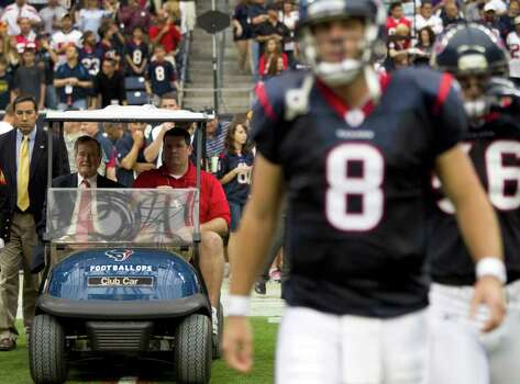 Former President George H.W. Bush is driven to the field flip the coin before an NFL football game between the Houston Texans and the Cleveland Browns at Reliant Stadium on Sunday, Nov. 6, 2011, in Houston. Photo: Brett Coomer, Houston Chronicle / © 2011  Houston Chronicle