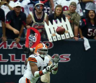 Cleveland Browns wide receiver Josh Cribbs (16) catches a 2-yard touchdown pass from quarterback Colt McCoy (12) during the fourth quarter of an NFL football game against the Houston Texans at Reliant Stadium on Sunday, Nov. 6, 2011, in Houston. Photo: Smiley N. Pool, Houston Chronicle / © 2011  Houston Chronicle