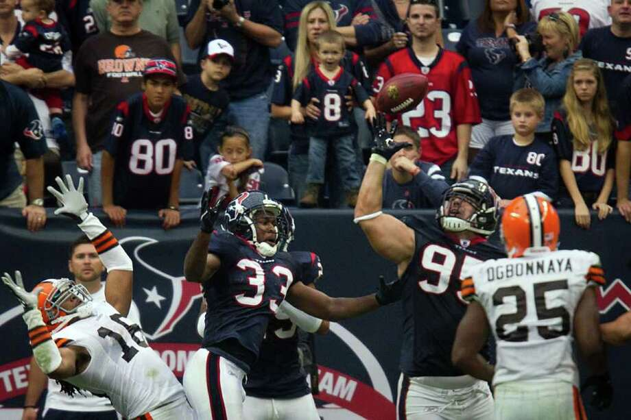 Houston Texans nose tackle Shaun Cody (95) intercepts a pass on a 2-point conversion attempt against the Cleveland Browns during the fourth quarter of an NFL football game at Reliant Stadium on Sunday, Nov. 6, 2011, in Houston. Photo: Smiley N. Pool, Houston Chronicle / © 2011  Houston Chronicle