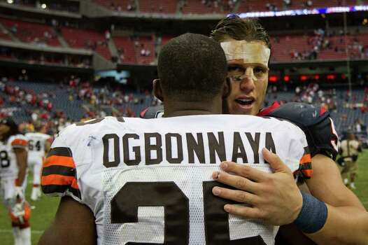 Houston Texans inside linebacker Brian Cushing hugs Cleveland Browns running back Chris Ogbonnaya after the Texans 30-12 victory in an NFL football game at Reliant Stadium on Sunday, Nov. 6, 2011, in Houston. Photo: Smiley N. Pool, Houston Chronicle / © 2011  Houston Chronicle