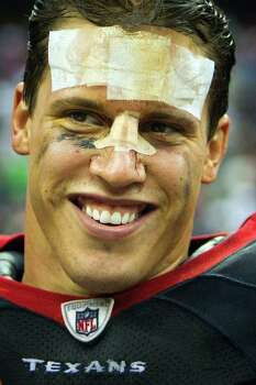 Houston Texans inside linebacker Brian Cushing, his face bandaged, smiles after the Texans 30-12 victory over the Cleveland Browns in an NFL football game at Reliant Stadium on Sunday, Nov. 6, 2011, in Houston. Photo: Smiley N. Pool, Houston Chronicle / © 2011  Houston Chronicle