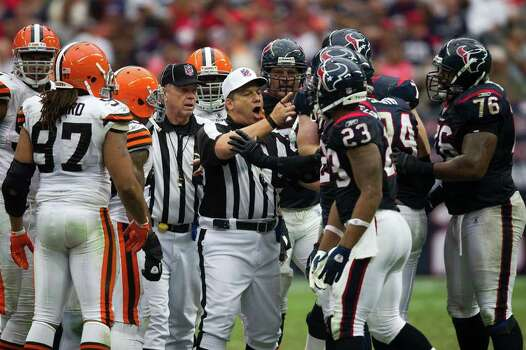 Officials step in to separate Houston Texans players from Cleveland Browns players during a shoving match between the teams during the third quarter of an NFL football game at Reliant Stadium on Sunday, Nov. 6, 2011, in Houston. Photo: Smiley N. Pool, Houston Chronicle / © 2011  Houston Chronicle