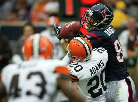 Houston Texans tight end Owen Daniels (81) has a pass go off of his hands as Cleveland Browns free safety Mike Adams (20) defends during the second quarter of an NFL football game at Reliant Stadium on Sunday, Nov. 6, 2011, in Houston. The deflected pass was intercepted by Browns linebacker D'Qwell Jackson. Photo: Smiley N. Pool, Houston Chronicle / © 2011  Houston Chronicle
