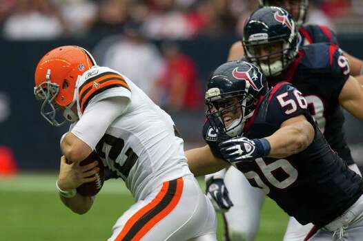 Cleveland Browns quarterback Colt McCoy (12) is sacked by Houston Texans inside linebacker Brian Cushing (56) during the second quarter of an NFL football game at Reliant Stadium on Sunday, Nov. 6, 2011, in Houston. Photo: Smiley N. Pool, Houston Chronicle / © 2011  Houston Chronicle